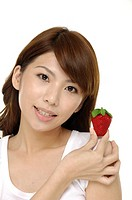 portrait of a beautiful woman with strawberry