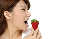 portrait of a beautiful Asian woman with strawberry