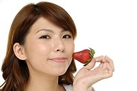 Full isolated portrait of a beautiful asian woman with strawberry