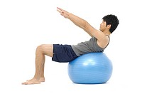 Man doing exercise on exercise ball