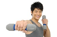 Portrait of a young man holding a dumbbell