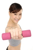 Woman lifting weights, close_up