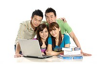 Group of university students using a laptop