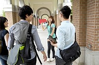 University students walking together in the corridor