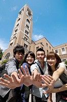 University students showing their palms in a campus