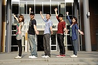 University students standing in a row with arms outstretched