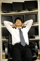 Businessman day dreaming in an office