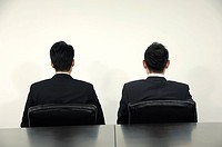 Businessmen sitting in a conference room