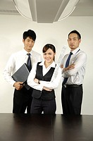 Business executives standing in an office