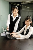 Businesswomen using a laptop in an office