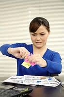 Female architect holding adhesive notes
