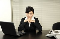 Businesswoman sitting in an office and smiling