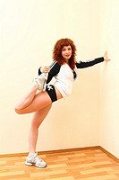 Pretty redhead young woman do fitness indoors