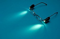 Reading eyeglasses with attached lights