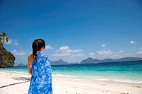 Rear view of a woman standing on the beach, El Nido, Palawan, Philippines