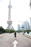 Rear view of a businesswoman looking at a tower, Oriental Pearl Tower, Pudong, Shanghai, China