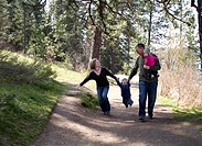 A young family walking at Tubbs Hill, Coeur d' Alene, Idaho, USA