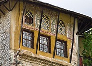 Traditional, ottoman style, painted decoration and wrought iron grills on a house in the old town of Gjirokastra in southern Albania