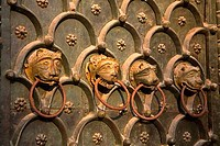 Close_up of doorknobs on the bronze door of a cathedral, Basilica di San Marco, Piazza San Marco, Venice, Italy