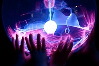 Small children´s hands on a Plasma Globe