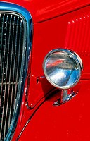 Close_up of the headlight of an antique car