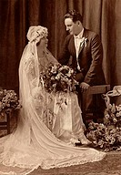 Newlywed couple looking at each other, c.1920