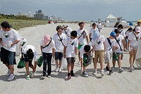 Florida, Miami Beach, Hands on Miami Beach Clean-up, litter, trash, pollution, environment, sand, volunteer, student, Hispanic, girl, teamwork, teache...