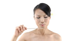 Close_up of a woman blowing an incense