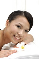 Close_up of a woman smiling in spa