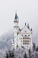 Snow covered mountains surround the famous Neuschwanstein castle, Schwangau, Bavaria, Germany