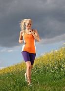 Woman jogging in meadow