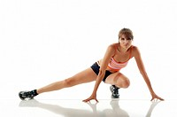 Hispanic fitness woman stretching