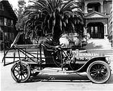 Vintage photograph of inventors in Vintage ´wind machine´ van