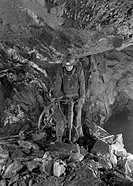 Miner drilling holes for blockholing boulders in a mine, Homestake Mine, South Dakota, USA