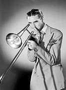 Studio shot of man playing trombone