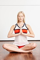 Blond young woman doing yoga exercise