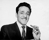 Portrait of businessman holding cigar and smiling