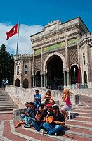 Musician playing music in front of an university, Istanbul University, Istanbul, Turkey