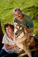 Portrait of middle aged couple with elder dog, MR 090522-1 and 090522-2