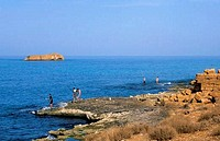 Libya, near Benghazi, Soussa, men fishing on coast
