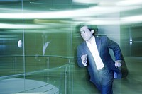 Businessman running in lobby
