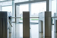 Turnstiles in building lobby