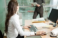Businesswoman working with colleague (thumbnail)