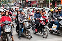 Traffic of motorbikes on the road, Hanoi, Vietnam