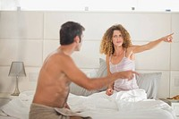 Couple arguing in bedroom