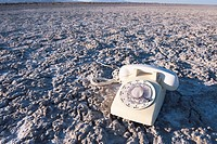 White Telephone on Dried Mud