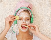 Teenage girl wearing beauty mask
