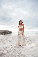 Woman in bikini and skirt on beach