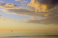 Paddle boarder in Pastel Ocean and Sky
