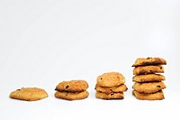 Stacks of fresh homemade cookies, white background
